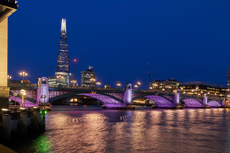 illuminated river southwark bridge